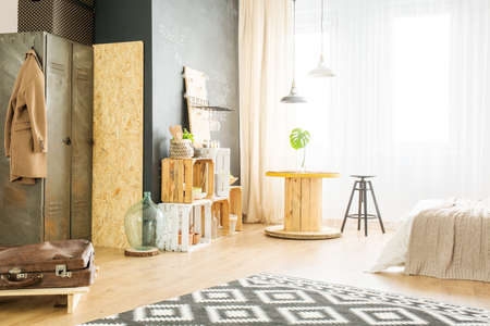 Bright apartment with upcycled furniture for young hipster