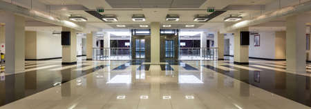 New big building of medical university with modern stylish hallway with two elevators