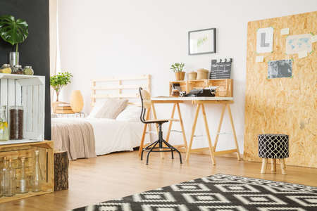Minimalist studio flat with bedroom and workspace for hipster Stock Photo - 82490791