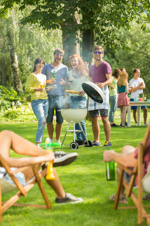Group of friends having fun during grilling together