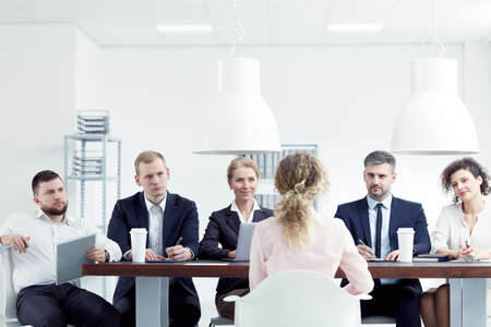 Blonde woman having interview for a job in corporation