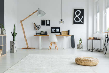 White and black working space in cozy apartment Stock Photo
