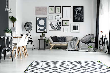 living room interior: Black and white living room with posters on the wall Stock Photo