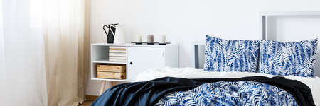 Modern Minimalist Bedroom Interior With Blue Bedsheets Stock Photo    82517713