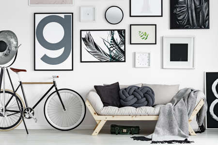 living room interior: Vintage bike by wooden sofa in scandinavian style living room Stock Photo