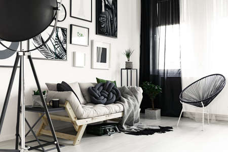 Wooden sofa and fancy black chair in modern designed living room