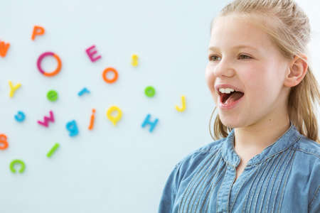 Copy space with little girl opening mouth in speech therapy office Stock Photo - 82516271
