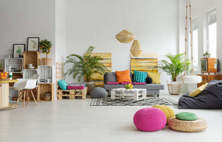View of retro colorful cozy living room in trendy loft