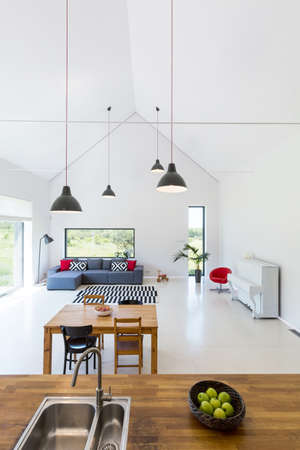 Interior of a detached house of a very modernistic shape and white walls, ceiling and floor Stock fotó