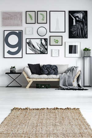 Modern living room in scandinavian style with wicker carpet
