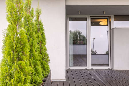 Entrance to home with transparent door Stock Photo
