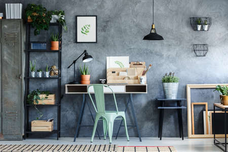 Loft office with industrial vintage decor of desk space Zdjęcie Seryjne - 82757067