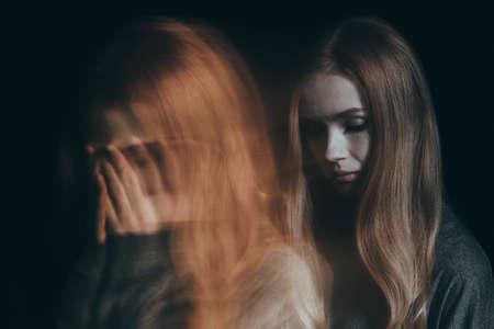 Girl with a mental disorder going through a tough time