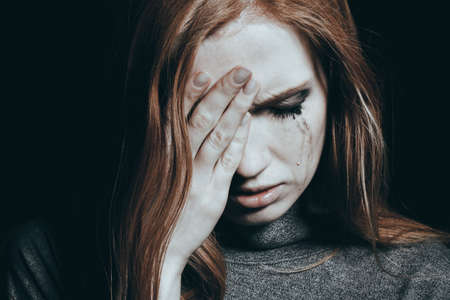 Tears falling down the girl's cheek because of her depression Stock Photo