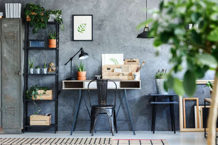 Plants and botanical illustrations in artistic office room interior