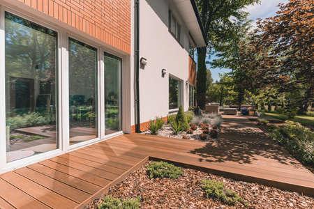 Villa porch with glass terrace door on sunny day Archivio Fotografico