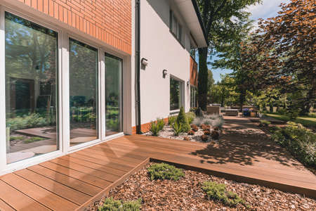 Villa porch with glass terrace door on sunny day Standard-Bild