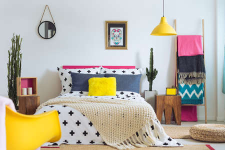 Festive bedroom of folk lover, mix of styles and materials