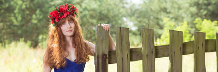 Beautiful young rural woman with long red hair