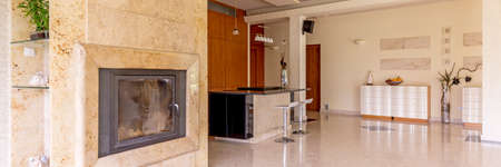 Beautiful elegant travertine fireplace in spacious fashionable interior