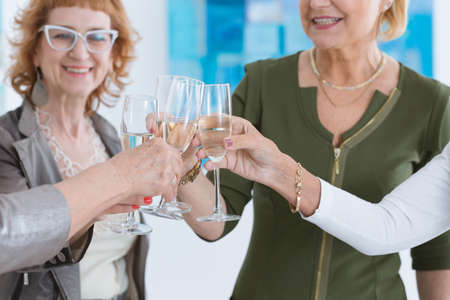 curator: Elder friends making a toast after successful opening