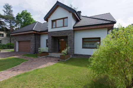 Modern house with the garden and brick walls
