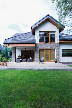 Modern and spacious house with brick walls and spacious patio