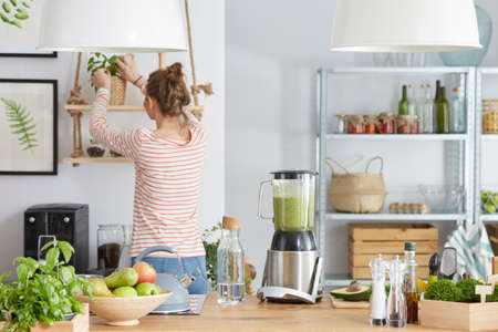 Woman in her eco,bio and modern kitchen