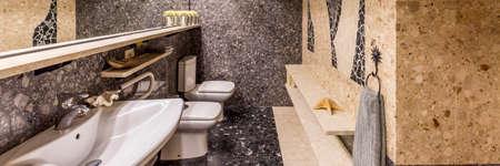 Granite pattern tiles in ethnic style toilet interior