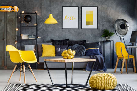 Living area in contemporary loft with splashes of yellow