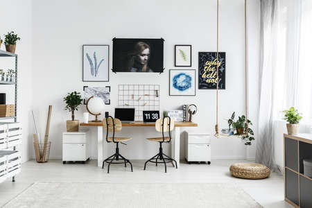 Spacious,white home workplace for creative hipster Stok Fotoğraf