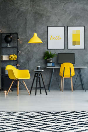Scandinavian room with workspace, patterned rug, wall and yellow details