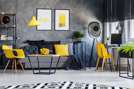 grey rug: Modern photography studio interior with retro lamp and desk workspace Stock Photo