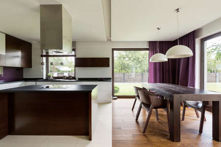 Modern kitchen with steely furniture and nice view Stock Photo