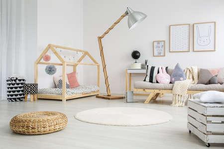 Creative scandinavian child's bedroom in modern apartment with big wooden lamp