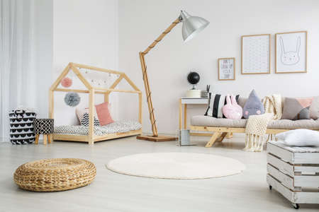 Creative scandinavian childs bedroom in modern apartment with big wooden lamp Stok Fotoğraf