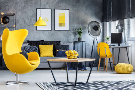grey rug: Hipster room with coffee table, yellow designer armchair and concrete walls