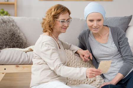 Woman with cancer and her friend recalling old memories together