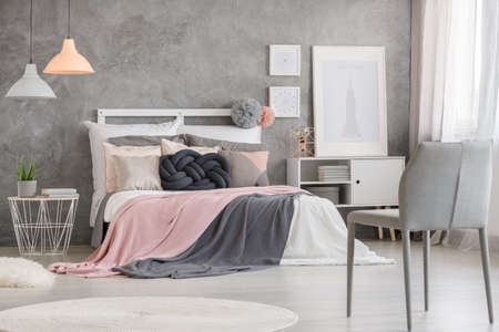 grey rug: White posters placed in stylish bedroom with design wall