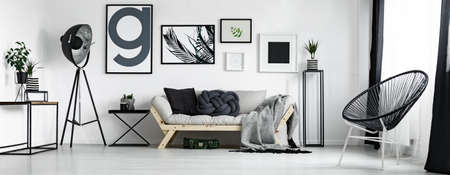Artists living room in minimal style with artworks Banco de Imagens