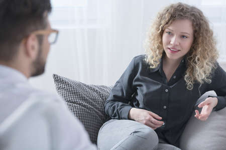 Woman talking with psychiatrist about her getting better Stok Fotoğraf - 83344203