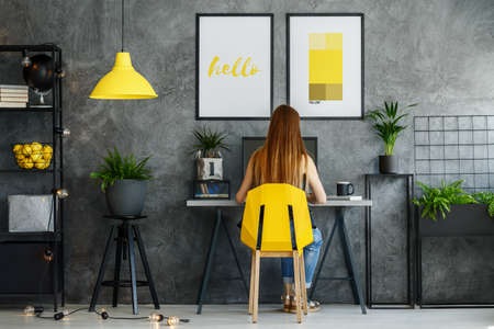 Office area in contemporary interior with yellow decor and modern