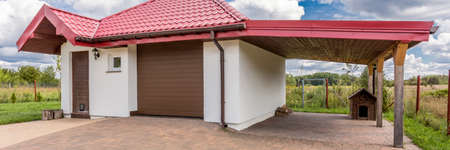 Contemporary one car garage with shelter and doghouse Stock Photo