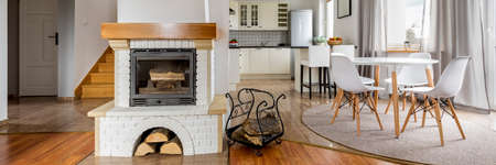 White brick fireplace in contemporary classic house interior