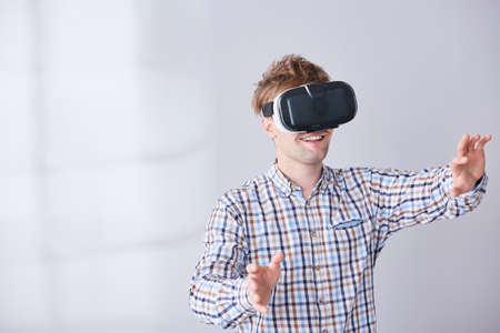 Happy boy with electronic device on head have fun in virtual reality Stock Photo