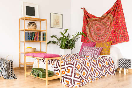 Boho and cozy bedroom in warm oriental colors Stock Photo