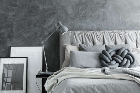 Close Up, Side View Of Cozy Modern Bedroom With Gray Headboard Stock Photo