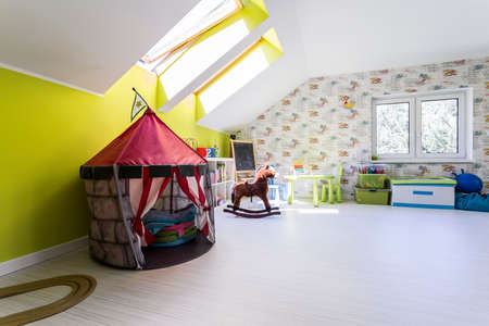 Room with a tent to grant wonderful playful time Stock Photo