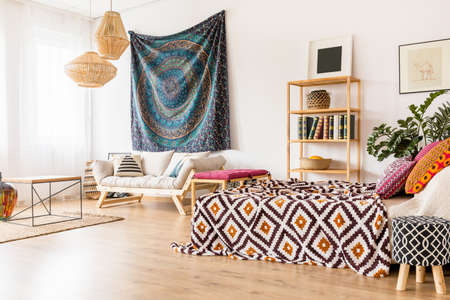Studio interior in ethnic style with simple wooden furniture Zdjęcie Seryjne - 83595875