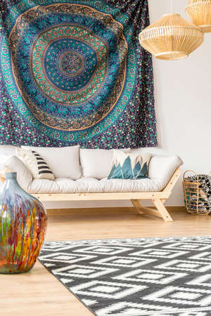 Modern sofa and ethnic cloth in living room